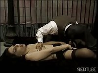 Pervert tortures young shemale in dungeon