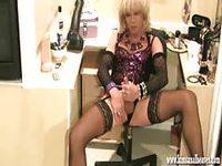 Hot shemale masturbating on chair