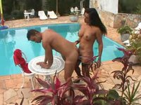Couple fucking anal by the swimming pool