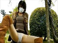 Sexy masked she male exposes herself in public playground