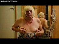 Sadist blonde tranny clamping her titties