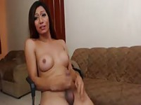 Happy young ladyboy stroking her cock and cumming hard