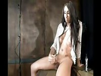 Dark skinned tranny shoots out cum