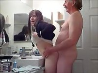 Cute young shemale fucks her old man in the bathroom