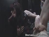 Shemales take turns sucking glory hole cock