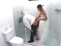 Shemale bride bends her groom over in the bathroom