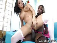 Beautiful black shemale gets her big cock sucked