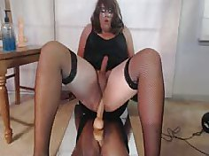 Chubby tranny stroking her cock while riding her guy