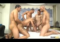Tattooed blonde transsexual getting gangbanged by a horde of men