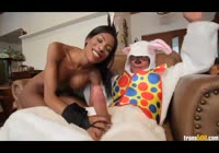 Fit ebony transsexual gets horny and fucks a dude in a rabbit costume