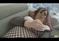 Luscious plump transsexual in fishnet pantyhose exposed