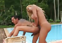 Poolside fuck session featuring a blonde tranny nailing a brunette dude