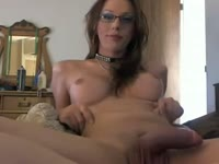 Petite amateur shemale slut Clarity Dawn wears sexy glasses while stroking her har meat stick