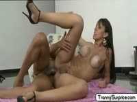 Tranny Gisele Ferrera looks hot tanned and toned while being screwed anally by a dude