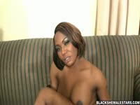 Ebony shemale Honey models her enormous breasts and fine round ass in this video
