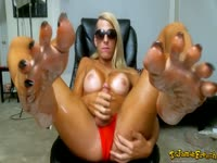 Blonde transsexual bombshell Jamie French modeling her tan body while jerking her big dick