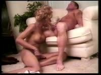 Fit and tanned transsexual cougar Lisa Lawrence slurping a dudes dick while jerking off