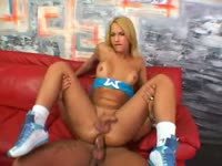 Tanned and toned college-aged transsexual Suzanny Petrovyck opens her long legs for anal