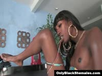 Black shemale shows her lovely tits in the living room