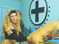 Bent over dude moans in pleasure as a well endowed blonde tranny penetrates him anally