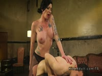Docile twink with a nice size cock bound in BDSM restraints and nailed by sexy transsexual