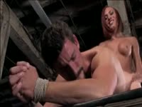 Attentive man with a tight asshole bound in BDSM restraints and hammered by hung tranny