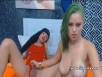 Green haired horny girl treats shemale to tug job before bending over and getting fucked while live